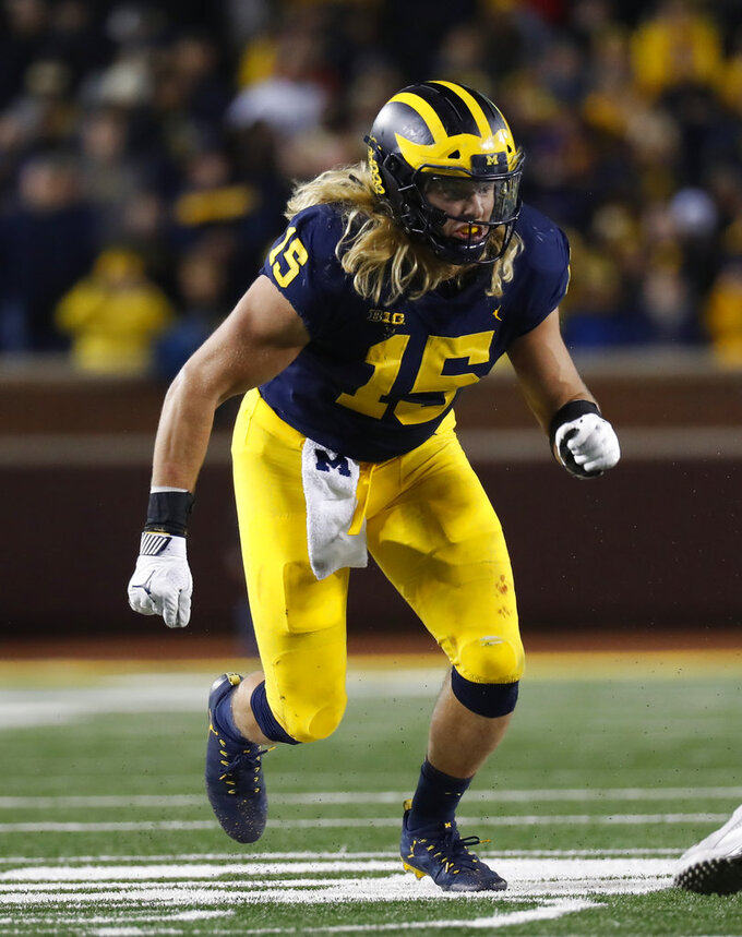 FILE - In this Oct. 13, 2018, file photo, Michigan defensive lineman Chase Winovich plays against Wisconsin in the second half of an NCAA college football game, in Ann Arbor, Mich. Winovich was named to The Associated Press Midseason All-America team, Tuesday, Oct. 16, 2018. (AP Photo/Paul Sancya, File)