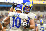 Los Angeles Rams wide receiver Cooper Kupp (10) is hugged after his touchdown catch during the first half of an NFL football game against the Tampa Bay Buccaneers Sunday, Sept. 26, 2021, in Inglewood, Calif. (AP Photo/Kevork Djansezian)