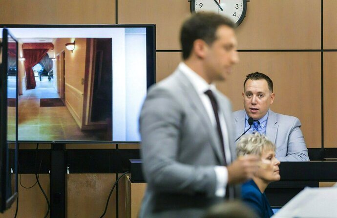 A photo showing the interior of the Orchids of Asia Day Spa is shown as Alex Spiro, attorney for Robert Kraft, questions Jupiter Police Detective Andrew Sharp during a motion hearing in West Palm Beach, Fla., Friday, April 26, 2019. (Lannis Waters/Palm Beach Post via AP)