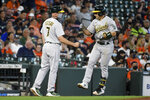 Oakland Athletics' Ramon Laureano, right, celebrates his two-run home run with third base coach Mark Kotsay during the fifth inning of a baseball game against the Houston Astros, Saturday, April 10, 2021, in Houston. (AP Photo/Eric Christian Smith)
