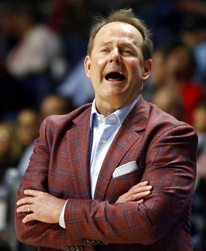 Mississippi head coach Kermit Davis calls out to his players during the first half of an NCAA college basketball game against Kentucky in Oxford, Miss., Tuesday, March 5, 2019. (AP Photo/Rogelio V. Solis)
