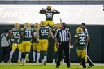 Green Bay Packers' Chandon Sullivan celebrates his interception and touchdown return during the second half of an NFL football game against the Detroit Lions Sunday, Sept. 20, 2020, in Green Bay, Wis. (AP Photo/Mike Roemer)