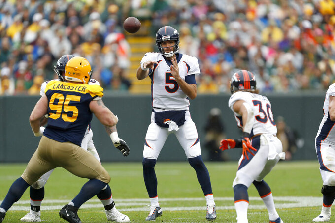 Denver Broncos quarterback Joe Flacco (5) throws a pass during the first half of an NFL football game against the Green Bay Packers, Sunday, Sept. 22, 2019, in Green Bay, Wis. (AP Photo/Matt Ludtke)