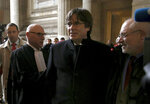 Catalonia's former regional president Carles Puigdemont, centre, arrives to the Justice Palace in Brussels, Monday, Dec.16, 2019. (AP Photo/Francois Walschaerts)