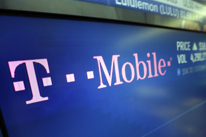 FILE - In this Feb. 14, 2018, file photo, the T-Mobile logo ppears on a screen at the Nasdaq MarketSite in New York. Yet another service provider is jumping into the TV streaming wars. This time it is T-Mobile, with its TVision service offering live news, entertainment and sports channels and starting at $10 a month.(AP Photo/Richard Drew, File)