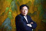 FILE - In this Dec. 3, 2012, file photo, Chinese real estate mogul Ren Zhiqiang poses for photos in his office in Beijing, China. Ren, the former chairman of a Chinese state-owned real estate company who publicly criticized President Xi Jinping's handling of the coronavirus pandemic was sentenced to 18 years in prison on Tuesday, Sept. 22, 2020 in a corruption case, the government announced. (Color China Photo via AP, File)