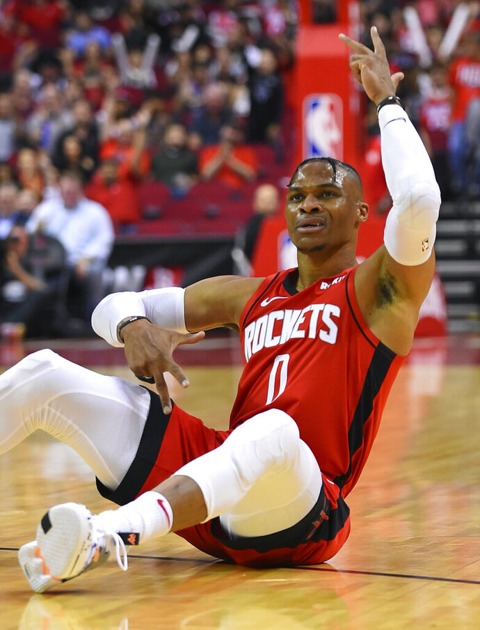 Houston Rockets guard Russell Westbrook reacts after making a 3-point basket during the first half of the team's NBA basketball game against the Milwaukee Bucks, Thursday, Oct. 24, 2019, in Houston. (AP Photo/Eric Christian Smith)