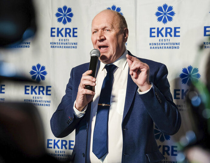 FILE - In this Monday, March 4, 2019 file photo, Chairman of the Estonian Conservative People's Party (EKRE) Mart Helme speaks at the headquarters after parliamentary elections in Tallinn, Estonia. The father-and-son leaders of a divisive anti-immigrant party were sworn in Monday April 29, 2019 as Estonia's interior and finance minister. EKRE's Mart Helme was appointed interior minister in the Cabinet, while his son Martin becomes finance minister. (AP Photo/Tanel Meos, File)