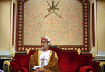 FILE - In this Feb. 21, 2020 file photo, Oman's ruler Sultan Haitham bin Tariq prepares for a meeting at al-Alam palace in the capital Muscat, Oman. The sultan announced Monday, Jan. 11, 2021, a shake-up of the country's constitution with changes that include the appointment of a crown prince for the first time and steps to boost government transparency. The move, one year after the death of Sultan Qaboos bin Said comes as the government faces growing economic pressures at home. (Andrew Caballero-Reynolds/Pool via AP, File)