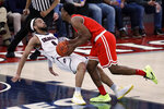 St. Francis' Keith Braxton, right, fouls Robert Morris' Josh Williams (0) during the first half of an NCAA college basketball game for the Northeastern Conference men's tournament championship in Pittsburgh, Tuesday, March 10, 2020. (AP Photo/Gene J. Puskar)