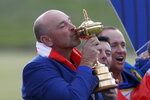 FILE - In this Sept. 30, 2018, file photo, Europe team captain Thomas Bjorn kisses the cup during the trophy presentation after the European team defeated the United States to win the 2018 Ryder Cup golf tournament at Le Golf National in Saint Quentin-en-Yvelines, outside Paris, France. The Ryder Cup was postponed until 2021 in Wisconsin because of the COVID-19 pandemic that raised too much uncertainty whether the loudest event in golf could be played before spectators. The announcement Wednesday, July 8, 2020, was inevitable and had been in the works for weeks as the PGA of America, the European Tour and the PGA Tour tried to adjust with so many moving parts.(AP Photo/Alastair Grant, File)