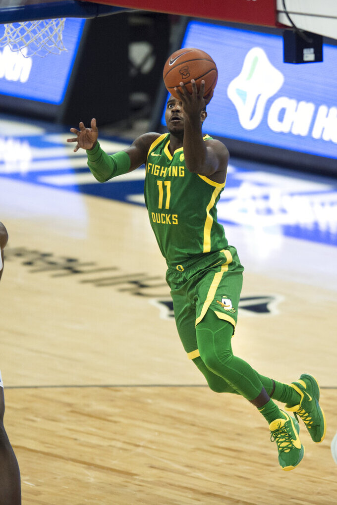 Oregon's Amauri Hardy Scores against Seton Hall during the second half of an NCAA college basketball game in Omaha, Neb., Friday, Dec. 4, 2020. (AP Photo/Kayla Wolf)