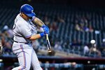 Texas Rangers' Yohel Pozo connects for an RBI double against the Arizona Diamondbacks during the sixth inning of a baseball game Wednesday, Sept. 8, 2021, in Phoenix. (AP Photo/Ross D. Franklin)