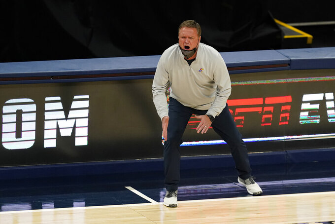 Kansas coach Bill Self shouts during the second half of the team's NCAA college basketball game against Kentucky, Tuesday, Dec. 1, 2020, in Indianapolis. (AP Photo/Darron Cummings)