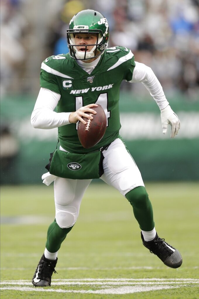New York Jets quarterback Sam Darnold (14) looks to pass during the first half of an NFL football game against the Oakland Raiders, Sunday, Nov. 24, 2019, in East Rutherford, N.J. (AP Photo/Adam Hunger)