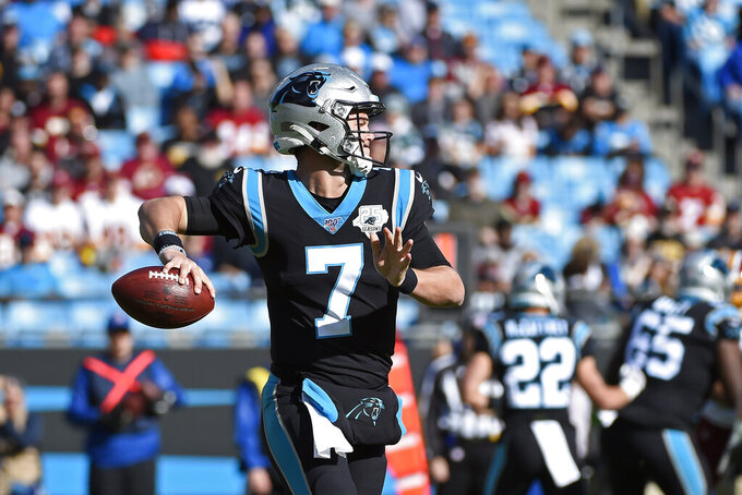 Carolina Panthers quarterback Kyle Allen (7) looks to pass during the first half of an NFL football game against the Washington Redskins in Charlotte, N.C., Sunday, Dec. 1, 2019. (AP Photo/Mike McCarn)