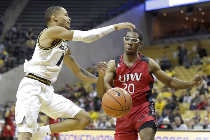 Missouri's Xavier Pinson, left, loses control of the ball next to Incarnate Word's Morgan Taylor (20) during the second half of an NCAA college basketball game Wednesday, Nov. 6, 2019, in Columbia, Mo. (AP Photo/Jeff Roberson)