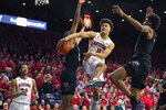 Arizona guard Josh Green (0) tries to pass the ball during the second half of the team's NCAA college basketball game against Washington on Saturday, March 7, 2020, in Tucson, Ariz. Washington won 69-63. (AP Photo/Rick Scuteri)