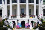 President Joe Biden appears with first lady Jill Biden and the Easter Bunny on the Blue Room balcony at the White House, Monday, April 5, 2021, in Washington. The annual Easter egg Roll at the White House was canceled due to the ongoing pandemic. (AP Photo/Evan Vucci)