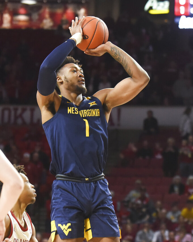 West Virginia forward Derek Culver shoots the ball during the first half of an NCAA college basketball game against Oklahoma in Norman, Okla., Saturday, Feb. 8, 2020. (AP Photo/Kyle Phillips)