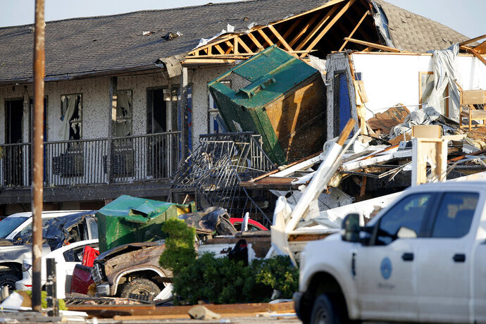 Part of a roof is exposed at the American Budget Value Inn after a tornado moved through the area in El Reno, Okla., Sunday, May 26, 2019. The deadly tornado leveled a motel and tore through the mobile home park near Oklahoma City overnight. (Bryan Terry/The Oklahoman via AP)