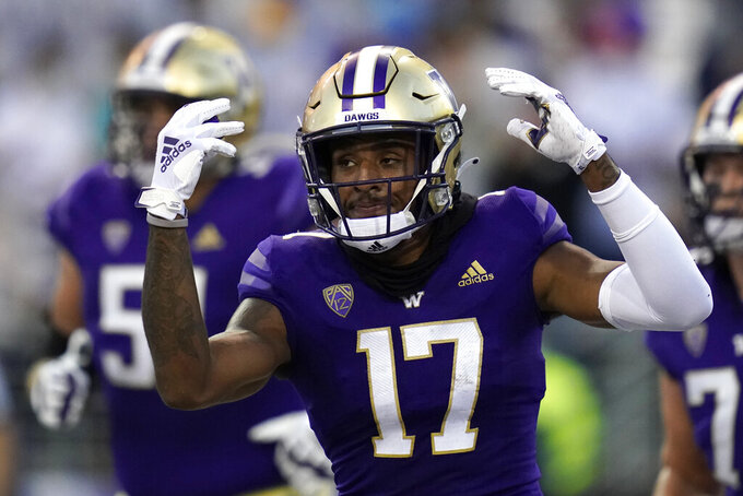 Washington wide receiver Taj Davis reacts after scoring a touchdown during the first half of an NCAA college football game against California, Saturday, Sept. 25, 2021, in Seattle. (AP Photo/Elaine Thompson)
