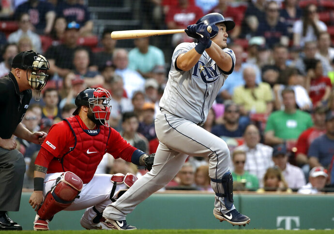 Tampa Bay Rays' Ji-Man Choi watches a solo home run in front of Boston Red Sox catcher Sandy Leon during the second inning of a baseball game at Fenway Park, Friday, June 7, 2019, in Boston. (AP Photo/Elise Amendola)