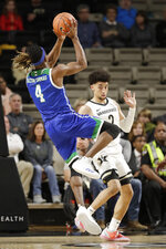 Texas A&M-Corpus Christi guard Jashawn Talton-Thomas (4) drives against Vanderbilt guard Scotty Pippen Jr. (2) in the first half of an NCAA college basketball game Monday, Nov. 11, 2019, in Nashville, Tenn. (AP Photo/Mark Humphrey)