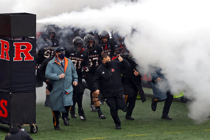 Rutgers head coach Greg Schiano leads his team on to the field to face Penn State in an NCAA college football game Saturday, Dec. 5, 2020, in Piscataway, N.J. Penn State won 23-7. (AP Photo/Adam Hunger)