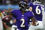 Baltimore Ravens quarterback Tyler Huntley passes against the Carolina Panthers during the first half of a preseason NFL football game Saturday, Aug. 21, 2021, in Charlotte, N.C. (AP Photo/Jacob Kupferman)