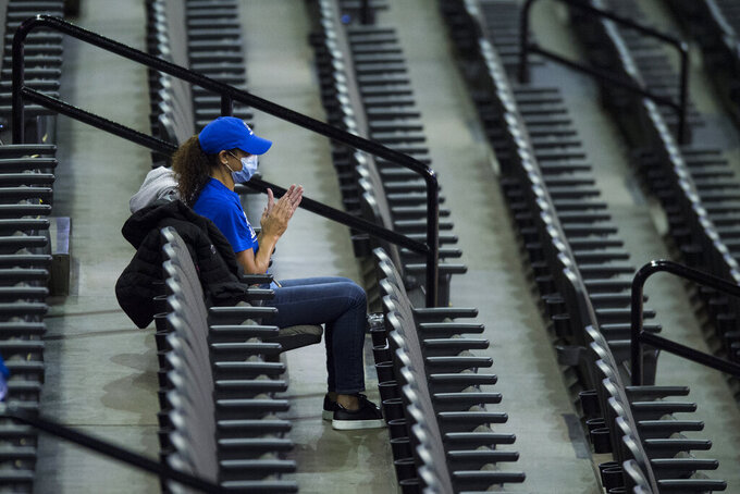 A Creighton fan celebrates a basket against Kennesaw State during the first half of an NCAA college basketball game in Omaha, Neb., Friday, Dec. 4, 2020. (AP Photo/Kayla Wolf)