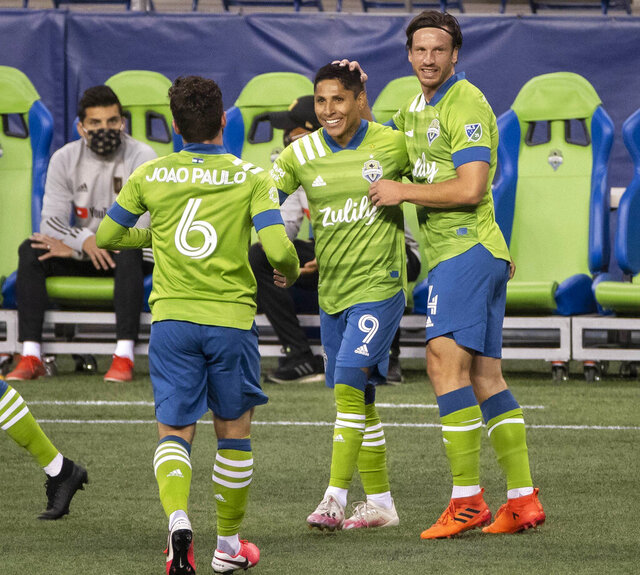 Seattle Sounders' Raul Ruidiaz (9) is congratulated after scoring in the 12th minute of an MLS soccer match against LAFC, Sunday, Aug. 30, 2020, in Seattle. (Dean Rutz/The Seattle Times via AP)