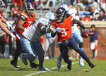 Virginia's quarterback Bryce Perkins (3) scrambles away from two North Carolina defenders in the first half of an NCAA college football game Saturday, Oct. 27, 2018, in Charlottesville, Va. (Zack Wajsgras /The Daily Progress via AP)
