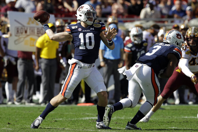 Auburn quarterback Bo Nix (10) throws a pass against Minnesota during the first half of the Outback Bowl NCAA college football game Wednesday, Jan. 1, 2020, in Tampa, Fla. (AP Photo/Chris O'Meara)
