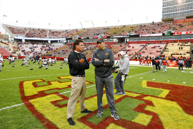 FILE - In this Nov. 11, 2017, file photo, Oklahoma State head coach Mike Gundy, left, talks with Iowa State head coach Matt Campbell before an NCAA college football game in Ames, Iowa. The two teams meet on Saturday. (AP Photo/Charlie Neibergall, File)