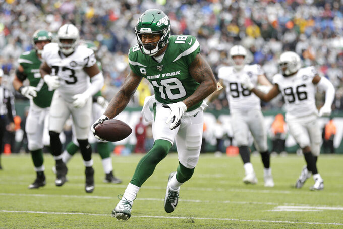 ADDS THAT THE TOUCHDOWN WAS LATER NULLIFIED BY PENALTY - New York Jets wide receiver Demaryius Thomas (18) runs for a touchdown during the first half of an NFL football game against the Oakland Raiders Sunday, Nov. 24, 2019, in East Rutherford, N.J. The touchdown was later nullified by penalty. (AP Photo/Adam Hunger)