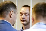 Ivan Safronov, an adviser to the director of Russia's state space corporation, stands behind bars in a courtroom in Moscow, Russia, Tuesday, July 7, 2020. Safronov, a former journalist who worked as an adviser to the director of the Russian state space corporation, pleaded innocent to the treason charges against him. Ivan Safronov, a former journalist who served as an adviser to Roscosmos head Dmitry Rogozin, was detained in Moscow by agents of the Federal Security Service (FSB), the main KGB successor agency. (Sofia Sandurskaya, Moscow News Agency photo via AP)