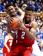 Duke's Javin DeLaurier (12) and North Carolina State's Torin Dorn (2) battle for the ball during the first half of an NCAA college basketball game in Durham, N.C., Saturday, Feb. 16, 2019. (AP Photo/Chris Seward)