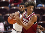 St. John's LJ Figueroa, left, steals the ball from Massachusetts' Tre Mitchell during the first half of an NCAA college basketball game, Sunday, Nov. 24, 2019, in Uncasville, Conn. (AP Photo/Jessica Hill)