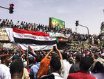 Demonstrators gather in Sudan's capital of Khartoum, Friday, April 12, 2019. The Sudanese protest movement has rejected the military's declaration that it has no ambitions to hold the reins of power for long after ousting the president of 30 years, Omar al-Bashir. (AP Photo)