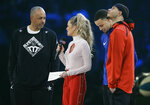 Dell Curry and son's Stephen Curry and Seth Curry are interviewed during the NBA All-Star 3-Point contest, Saturday, Feb. 16, 2019, in Charlotte, N.C. (AP Photo/Chuck Burton)