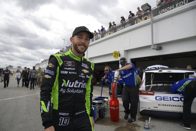FILE - In this Feb. 16, 2019, file photo, NASCAR driver Ross Chastain (10) walks through the garage area during a practice session for the NASCAR Daytona 500 auto race at Daytona International Speedway in Daytona Beach, Fla. Chastain opened the season with 36 consecutive starts across the Cup, XFinity and trucks series, a streak that's believed to be a record in stock car racing. Chastain has logged a staggering 7,501 laps since February, a streak that only came to an end when he sat out last week's Cup event in Michigan.(AP Photo/Phelan M. Ebenhack, File)