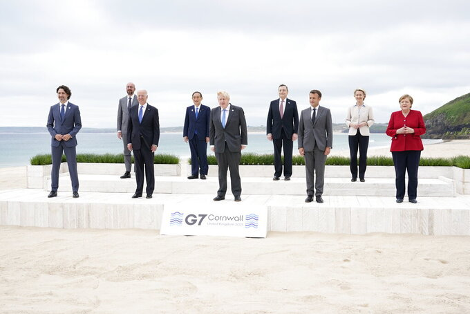 Leaders of the G7 pose for a group photo on overlooking the beach at the Carbis Bay Hotel in Carbis Bay, St. Ives, Cornwall, England, Friday, June 11, 2021. Leaders from left, Canadian Prime Minister Justin Trudeau, European Council President Charles Michel, U.S. President Joe Biden, Japan's Prime Minister Yoshihide Suga, British Prime Minister Boris Johnson, Italy's Prime Minister Mario Draghi, French President Emmanuel Macron, European Commission President Ursula von der Leyen and German Chancellor Angela Merkel. (AP Photo/Patrick Semansky, Pool)