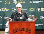 """FILE - In this Monday, Aug. 31, 2015, file photo, Baylor head football coach Art Briles addresses the media in Waco, Texas. The NCAA infractions committee said Wednesday, Aug. 11, 2021, that its years-long investigation into the Baylor sexual assault scandal would result in four years probation and other sanctions, though the """"unacceptable"""" behavior at the heart of the case did not violate NCAA rules. The NCAA ruling came more than five years after the scandal broke at the world's largest Baptist university, leading to the firing of successful football coach Art Briles, and the later departures of athletic director Ian McCaw and school president Ken Starr. (Jerry Larson/Waco Tribune-Herald via AP, File)"""