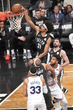 Brooklyn Nets center Jarrett Allen (31) dunks during the first half of Game 4 of a first-round NBA basketball playoff series against the Philadelphia 76ers, Saturday, April 20, 2019, in New York. (AP Photo/Mary Altaffer)