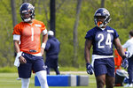 Chicago Bears quarterback Justin Fields (1) and running back Khalil Herbert (24) participate in drills during the NFL football team's rookie minicamp Friday, May, 14, 2021, in Lake Forest Ill. (AP Photo/David Banks, Pool)