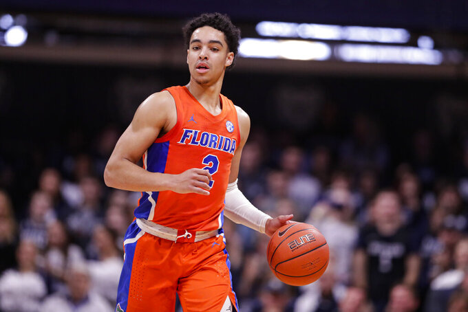 FILE - In this Dec. 7, 2019, file photo, Florida guard Andrew Nembhard (2) plays against Butler in the second half of an NCAA college basketball game in Indianapolis. Florida coach Mike White subtly divulges one of the reasons his team was among the biggest disappointments in college basketball last season. The Gators were simply too slow. (AP Photo/Michael Conroy, File)