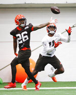 Cleveland Browns cornerback Greedy Williams (26) defends against Antonio Callaway (11) during practice at the team's NFL football training facility in Berea, Ohio, Thursday, June 6, 2019. (AP Photo/Ron Schwane)