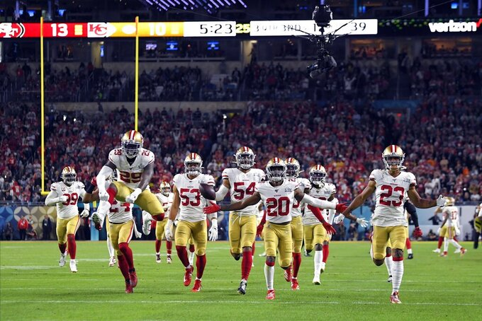 San Francisco 49ers' Fred Warner (54) and teammates celebrate his interception against the Kansas City Chiefs during the second half of the NFL Super Bowl 54 football game Sunday, Feb. 2, 2020, in Miami Gardens, Fla. (AP Photo/Mark J. Terrill)