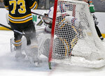 New York Rangers center Filip Chytil scores as he collides with Boston Bruins goaltender Tuukka Rask (40) ahead of Charlie McAvoy (73) during the first period of an NHL hockey game, Saturday, Jan. 19, 2019, in Boston. (AP Photo/Mary Schwalm)